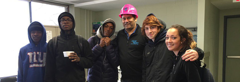 Students with teacher wearing pink OYAP hard hat